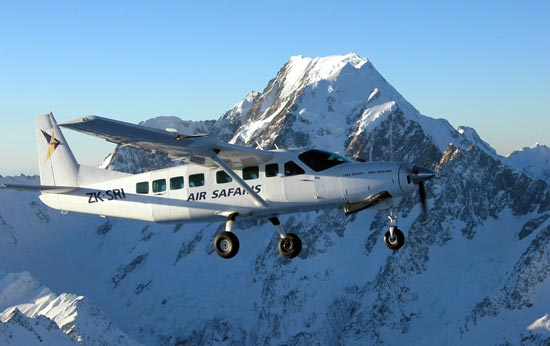 Air Safaris Cessna Caravan passing in front of Mt Cook